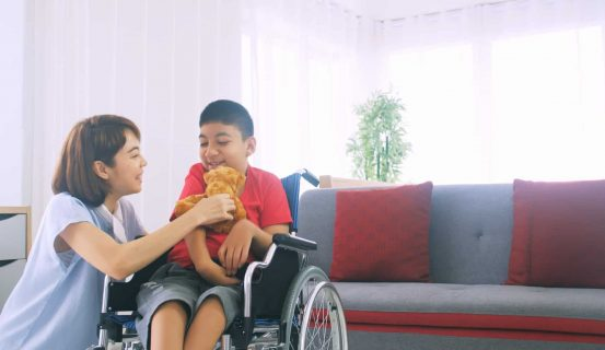 Happy,Family,With,Mother,And,Disabled,Son,Spending,Time,Together