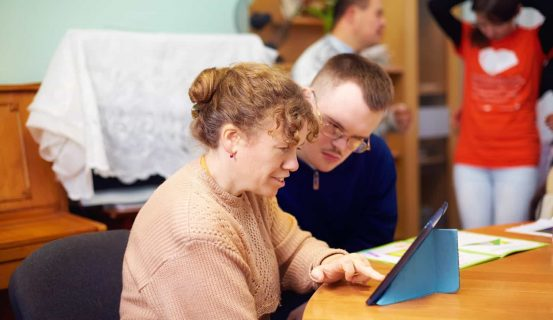 Two,Friends,With,Disability,In,Rehabilitation,Center,,Watching,Digital,Tablet
